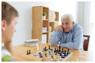 an elderly man playing chess